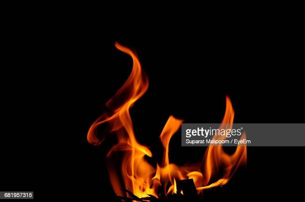 Close-Up Of Fire Burning Over Black Background