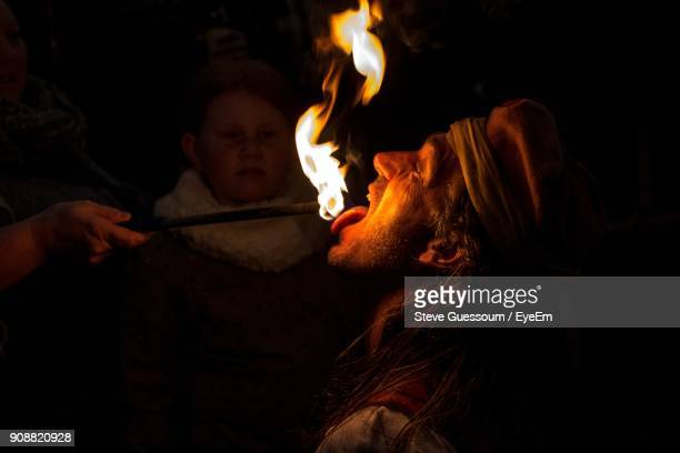 close-up of fire eater at night - steve guessoum stockfoto's en -beelden