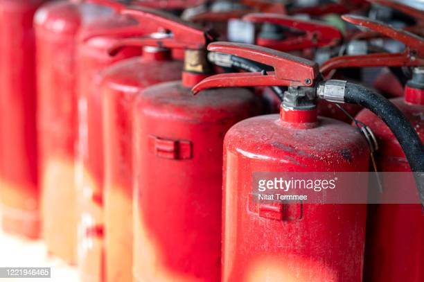 close-up of fire extinguisher (co2) in stock of fire station. - red alert 2 stock pictures, royalty-free photos & images