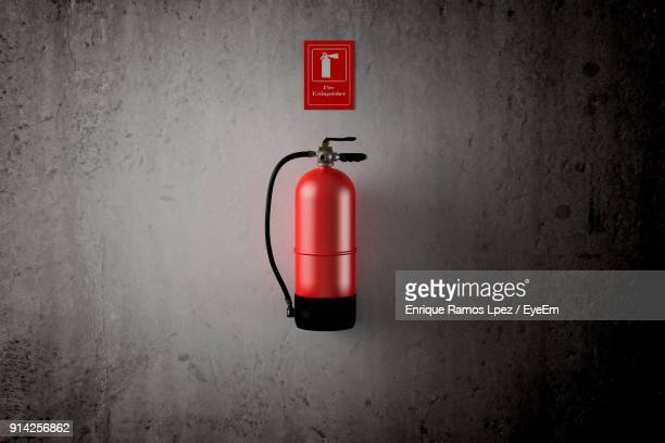 Close-Up Of Fire Extinguisher On Wall