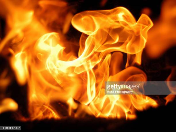 closeup of fire flames - flammable stock photos and pictures