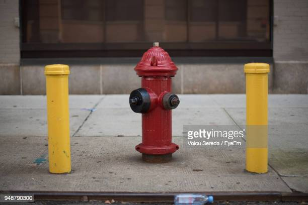 Close-Up Of Fire Hydrant At Sidewalk