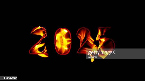 close-up of fire inscription of year 2025 - この撮影のクリップをもっと見る 2025 stock pictures, royalty-free photos & images