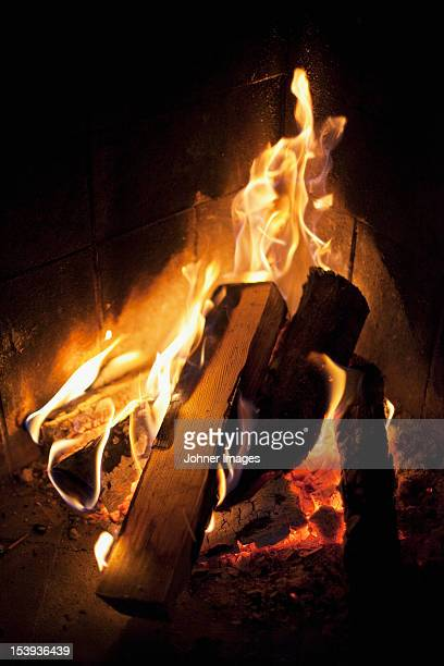 Close-up of fire with logs