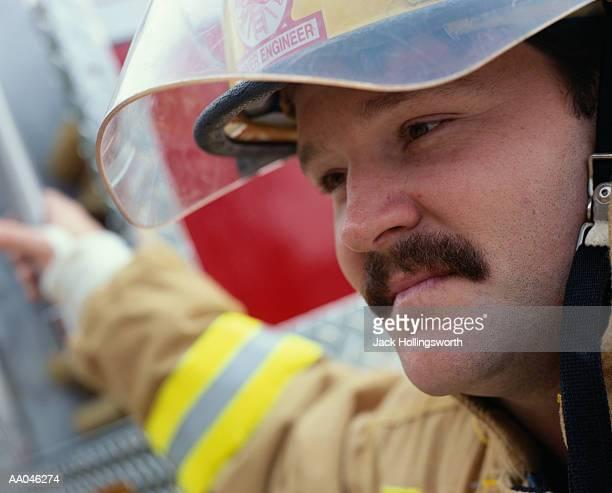 Close-up Of Fireman Wearing Helmet