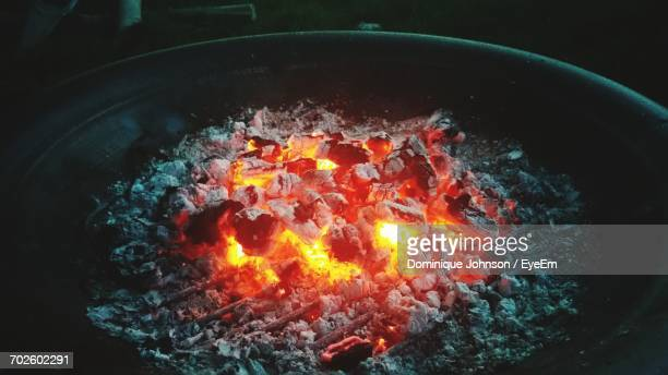 close-up of firewood burning in container - johnson stockfoto's en -beelden
