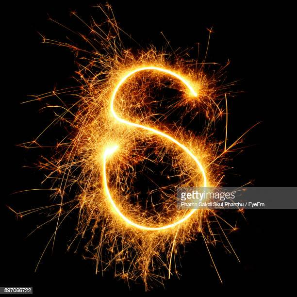 close-up of firework display against black background - letter s stock pictures, royalty-free photos & images