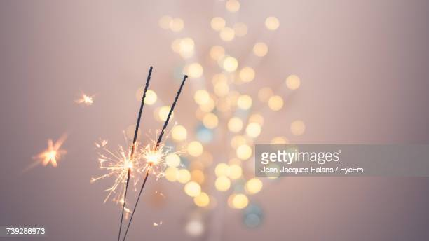 close-up of firework display at night - sparkler stock pictures, royalty-free photos & images