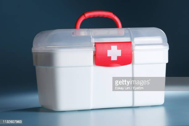 close-up of first aid box on table - first aid kit stock pictures, royalty-free photos & images