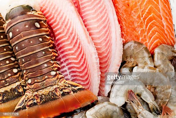 Closeup of fish, shrimp and lobsters on ice