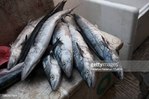 Close-Up Of Fishes In Box At Market