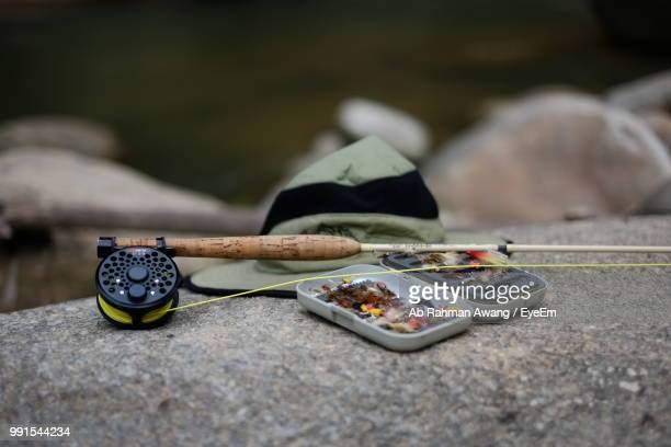 close-up of fishing equipment on rock - fishing tackle stock pictures, royalty-free photos & images