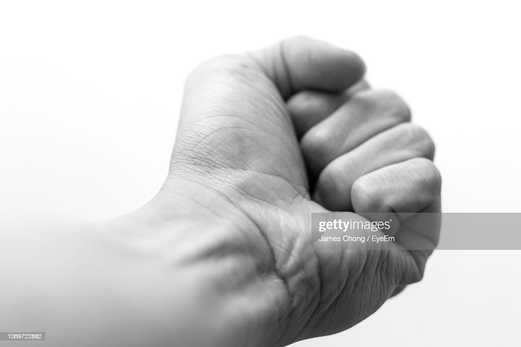 Close-Up Of Fist Against White Background : Stock Photo