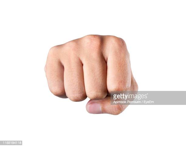 close-up of fist against white background - punching stock pictures, royalty-free photos & images