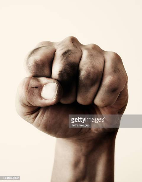 close-up of fist, studio shot - fist stock pictures, royalty-free photos & images