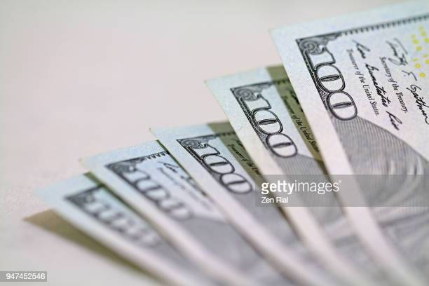 Close-up of five American one hundred dollar bills