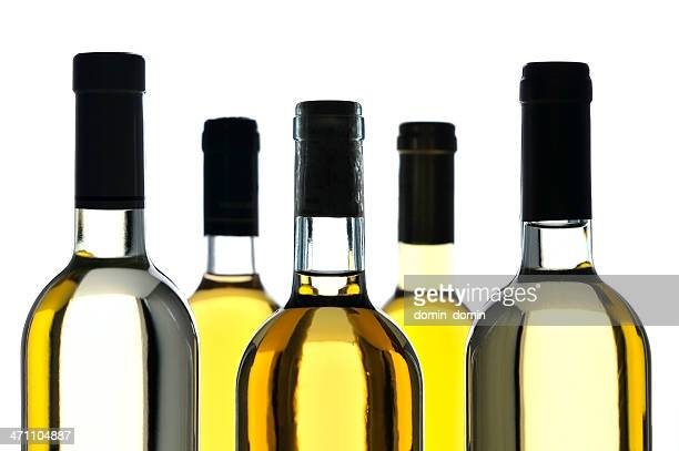 Close-up of five bottles of white wine isolated on white