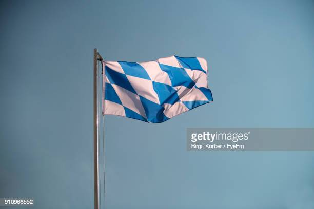 Close-Up Of Flag Against Clear Blue Sky