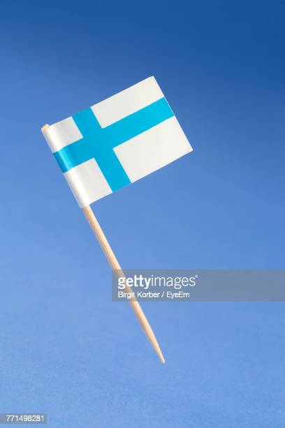Close-Up Of Flag On Blue Background