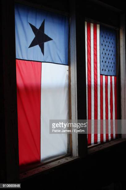 Close-Up Of Flags On Window
