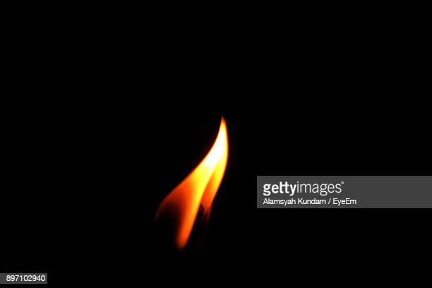 close-up of flame against black background - 炎 ストックフォトと画像