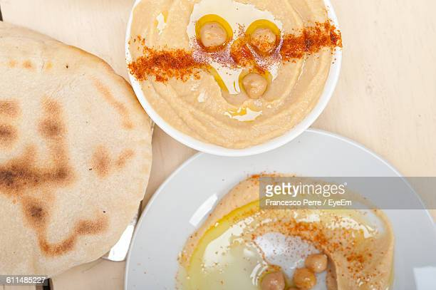 Close-Up Of Flat Bread With Hummus Served On Table