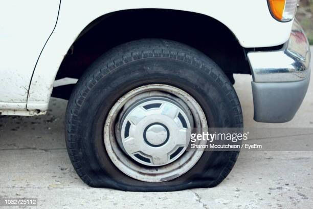 close-up of flat tire of car - puncturing stock pictures, royalty-free photos & images