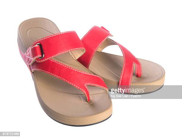 close-up of flip-flop against white background - sandal stock pictures, royalty-free photos & images
