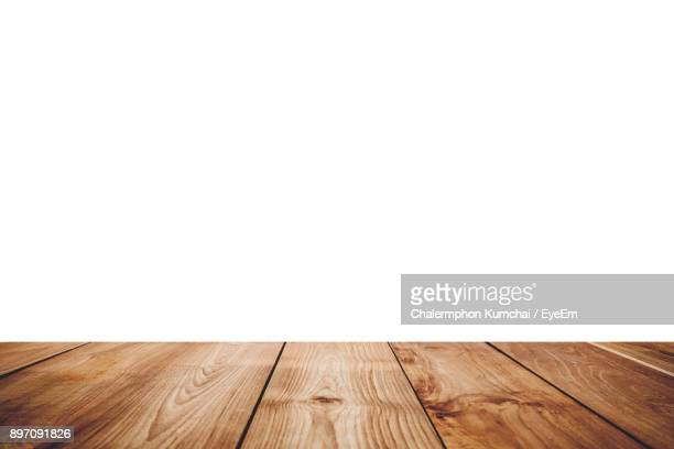 close-up of floorboard against white background - floorboard stock photos and pictures