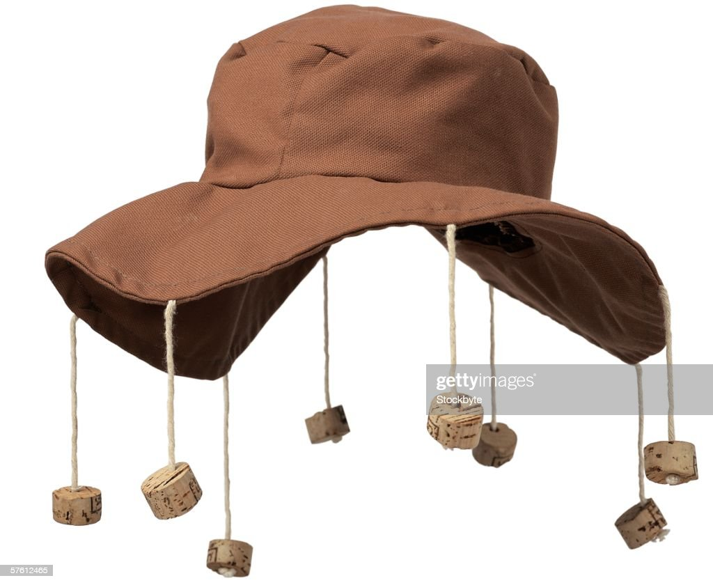 close-up of floppy hat with corks hanging from it : Stock Photo