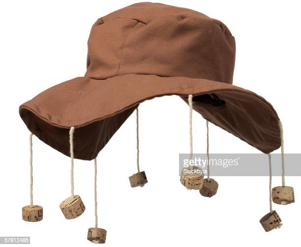 close-up of floppy hat with corks hanging from it - cork material stock photos and pictures