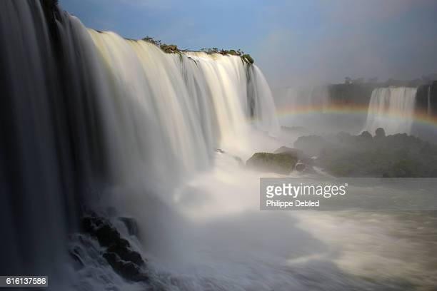 Close-up of Floriano Falls in long exposure at Iguazu Falls, Brazilian side, with Belgrano Falls on the Argentinean side at the background. Foz do Iguaçu, Paraná State, Brazil