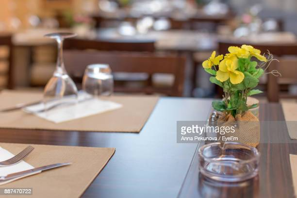 Close-Up Of Flower Vase On Table At Restaurant