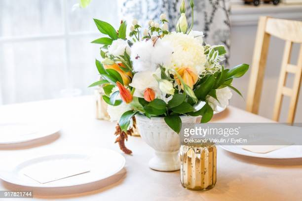 close-up of flower vase on table - oleksandr vakulin stock pictures, royalty-free photos & images