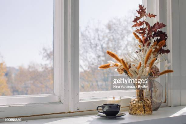 close-up of flower vase on window sill - autumn decoration stock pictures, royalty-free photos & images