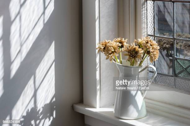 close-up of flower vase on window sill - window sill stock pictures, royalty-free photos & images