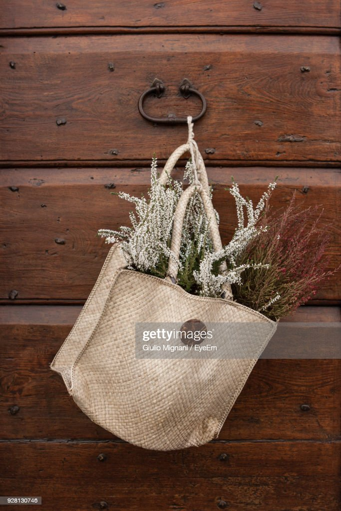 Closeup Of Flowers In Bag Hanging On Wooden Wall High-Res ...