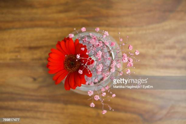 Close-Up Of Flowers In Jar On Table