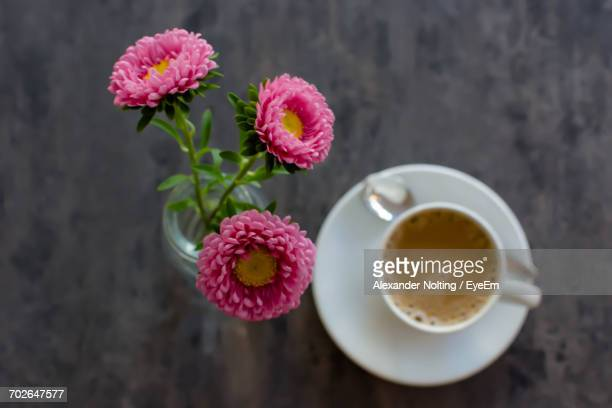 Close-Up Of Flowers In Vase And Coffee