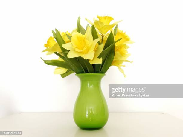 close-up of flowers in vase on table - vase stock pictures, royalty-free photos & images