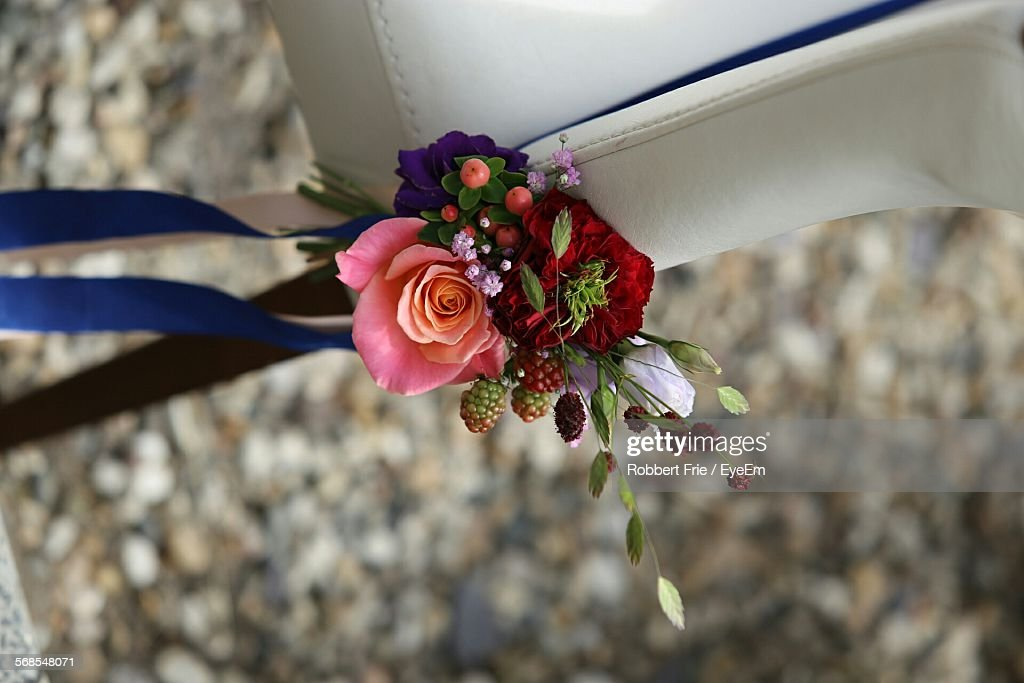 Close-Up Of Flowers Tied To Chair : Stock Photo