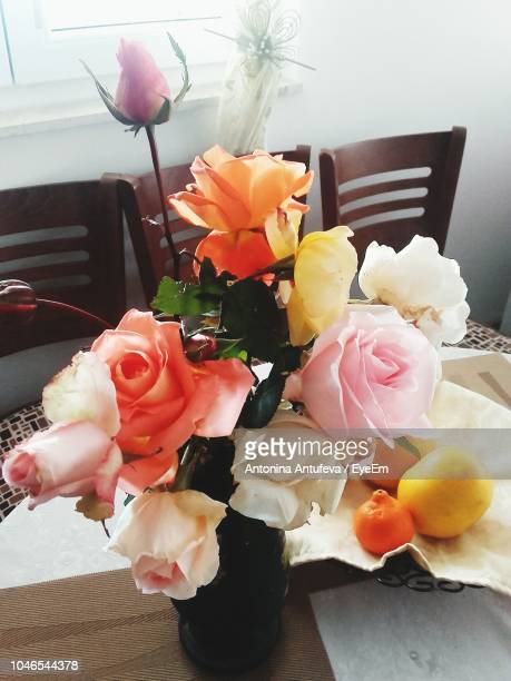 Close-Up Of Flowers Vase On Table
