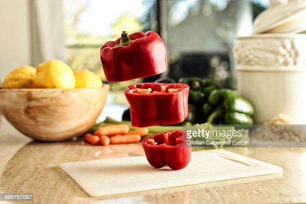 Close-Up Of Flying Chopped Bell Pepper On Table
