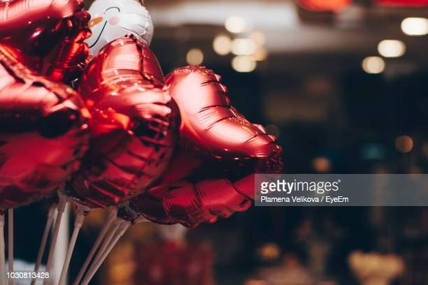 close-up of foil helium balloons for sale at market - helium balloon stock pictures, royalty-free photos & images