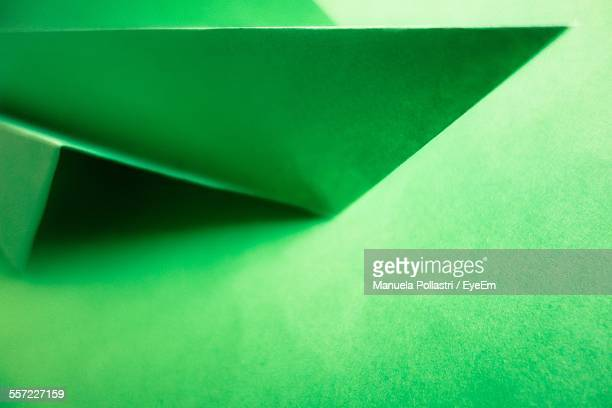 Close-Up Of Folded Green Paper