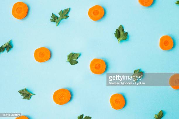 close-up of food against blue background - carrot stock pictures, royalty-free photos & images