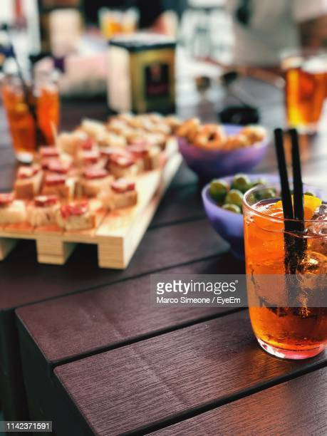 close-up of food and drink on table in restaurant - simeone stock pictures, royalty-free photos & images
