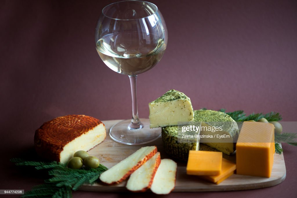Close-Up Of Food And Wine On Cutting Board : Stock Photo