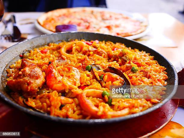 close-up of food in bowl - paella stock photos and pictures
