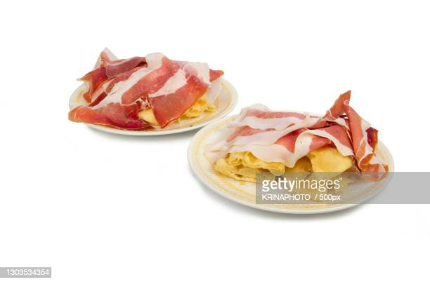 close-up of food in plate against white background,italia,italy - italia stockfoto's en -beelden